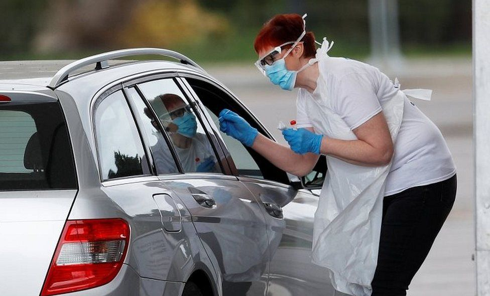 Health worker at drive-in coronavirus testing centre
