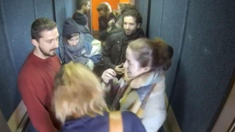 Shia LaBeouf (l) in a lift