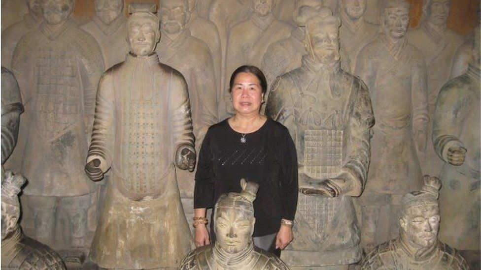 Sandy Phan-Gillis, posing amongst Chinese terracotta soldiers