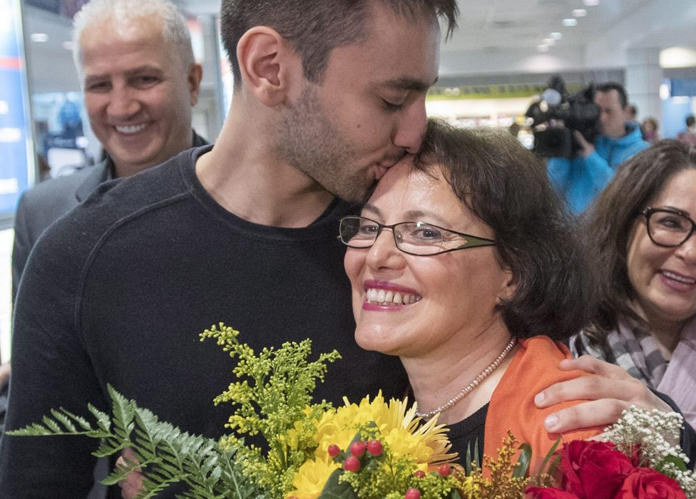 Homa Hoodfar gets a kiss from her nephew as she arrives at Trudeau airport