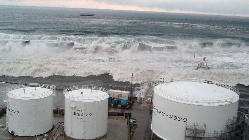 Waves breaching the sea wall of the Fukushima power plant, March 2011