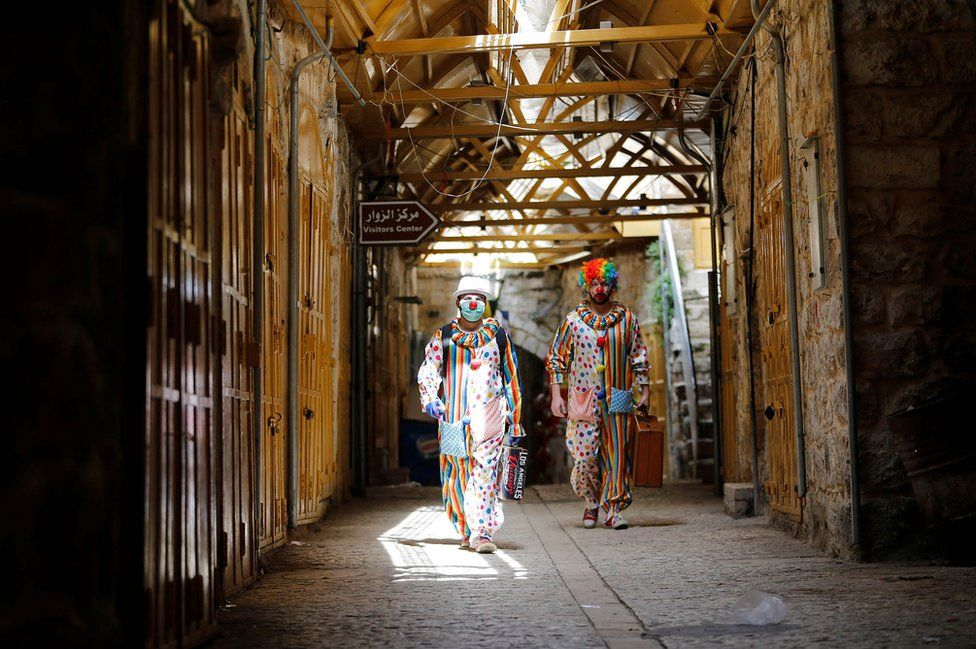 Clowns arrive to entertain Palestinian children in Hebron