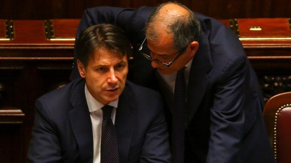 Italian Prime Minister Giuseppe Conte talks with Economy Minister Giovanni Tria