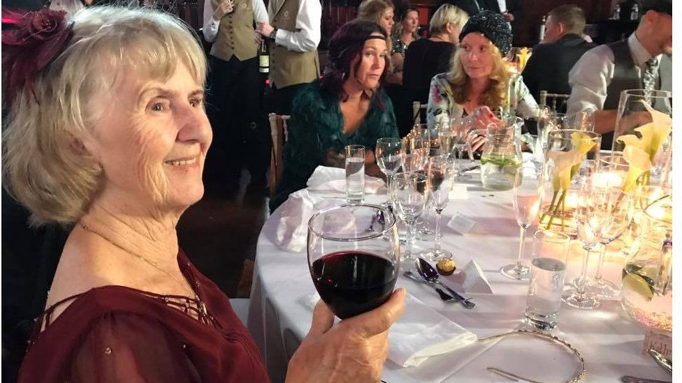 Guest with a glass of wine