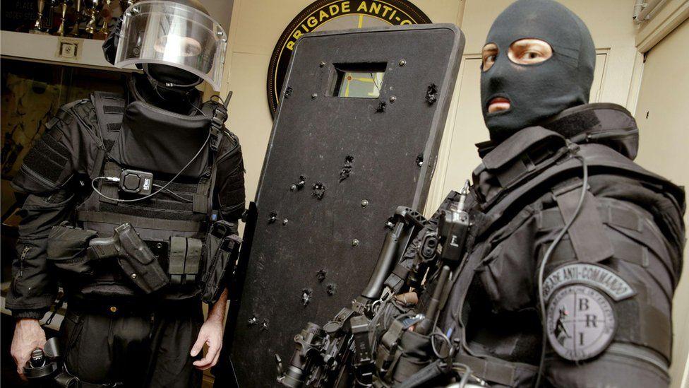Bataclan police with shield, 17 Nov 15