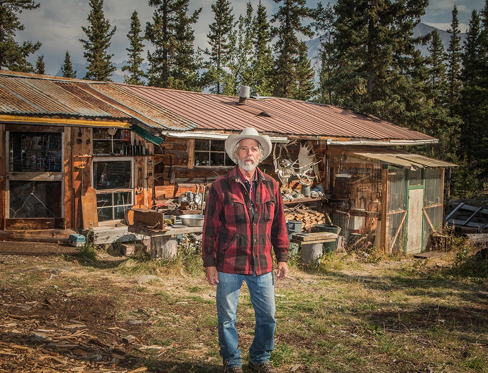 Gary Green standing outside a house