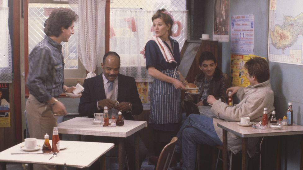 (L-R) Nejdet Salih, Oscar James, Sandy Ratcliff, John Altman and Tom Watt in an EastEnders episode in 1985
