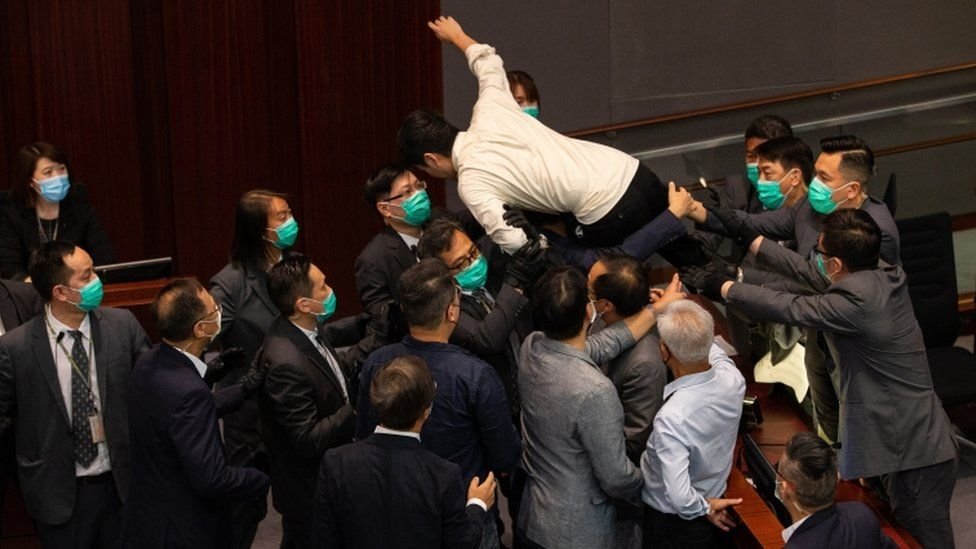 Pro-democracy lawmaker Ted Hui tried to jump onto the chairman's bench