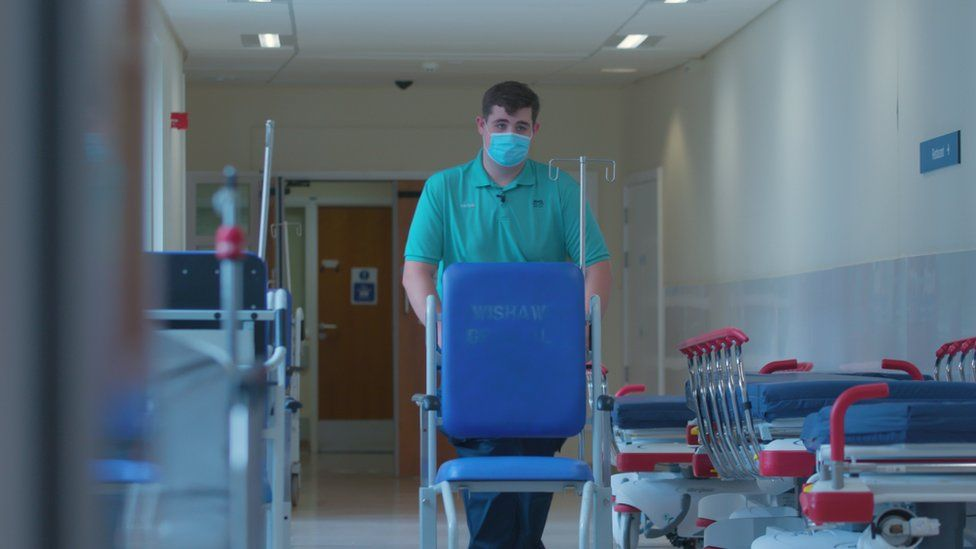 Aidan in his job as a porter