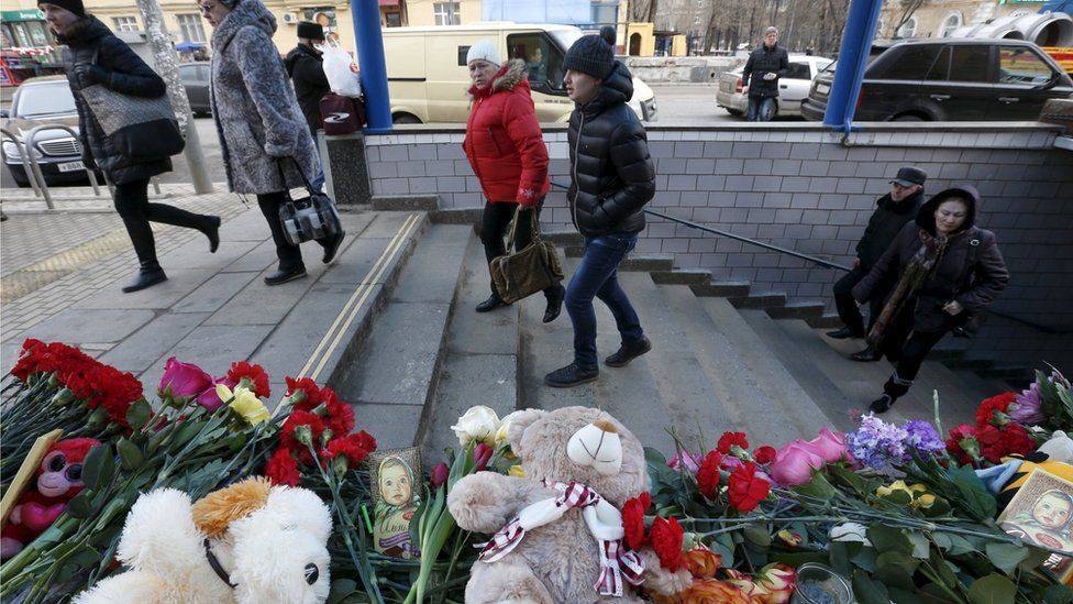Flowers, toys and other items are placed to commemorate recently murdered child at the entrance to the Oktyabrskoye Pole metro station in Moscow, Russia, March 1, 2016