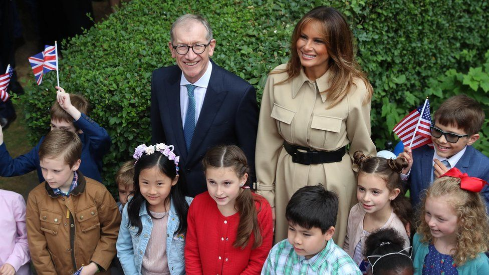 Melania Trump and Philip May with children at a garden party at 10 Downing Street