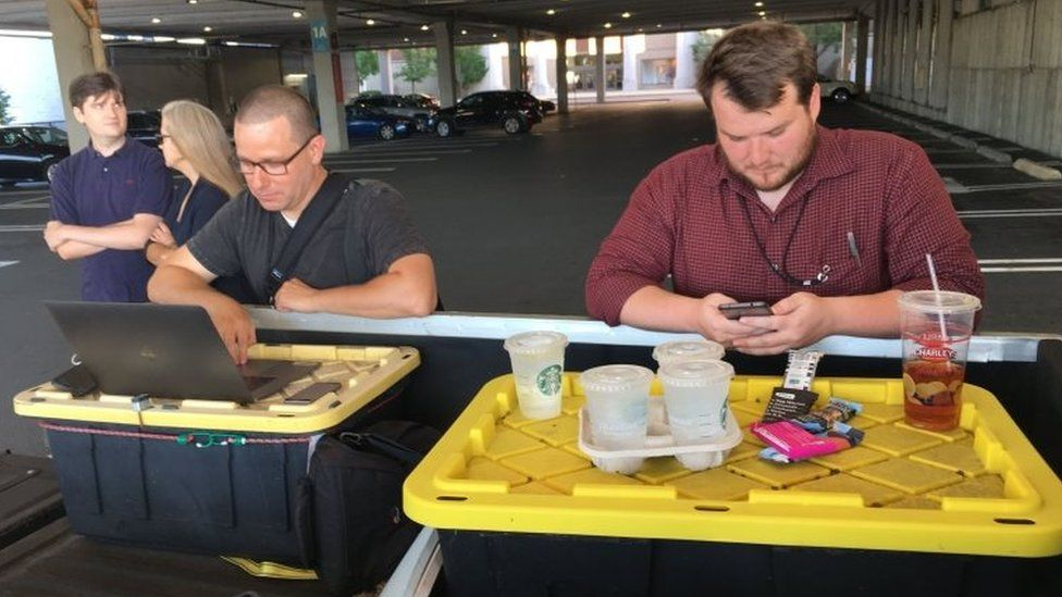 Capital Gazette reporter Chase Cook (R) and photographer Joshua McKerrow (L) work on the next days newspaper while awaiting news from their colleagues in Annapolis, Maryland, on 28 June 2018.