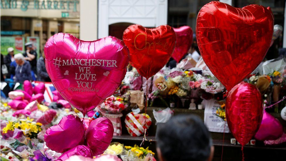 Flowers and tributes in St Ann's Square in Manchester