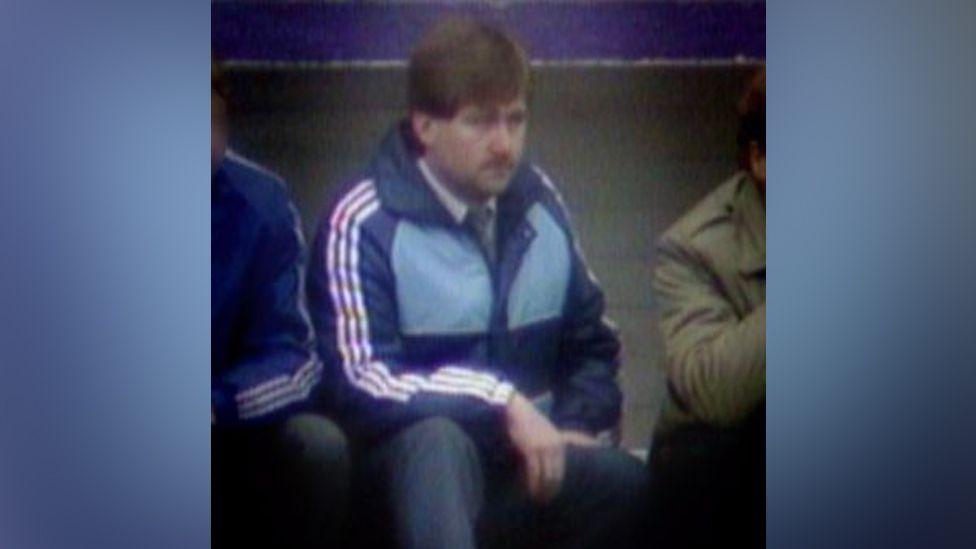 Gordon Neely in the Hibs dugout