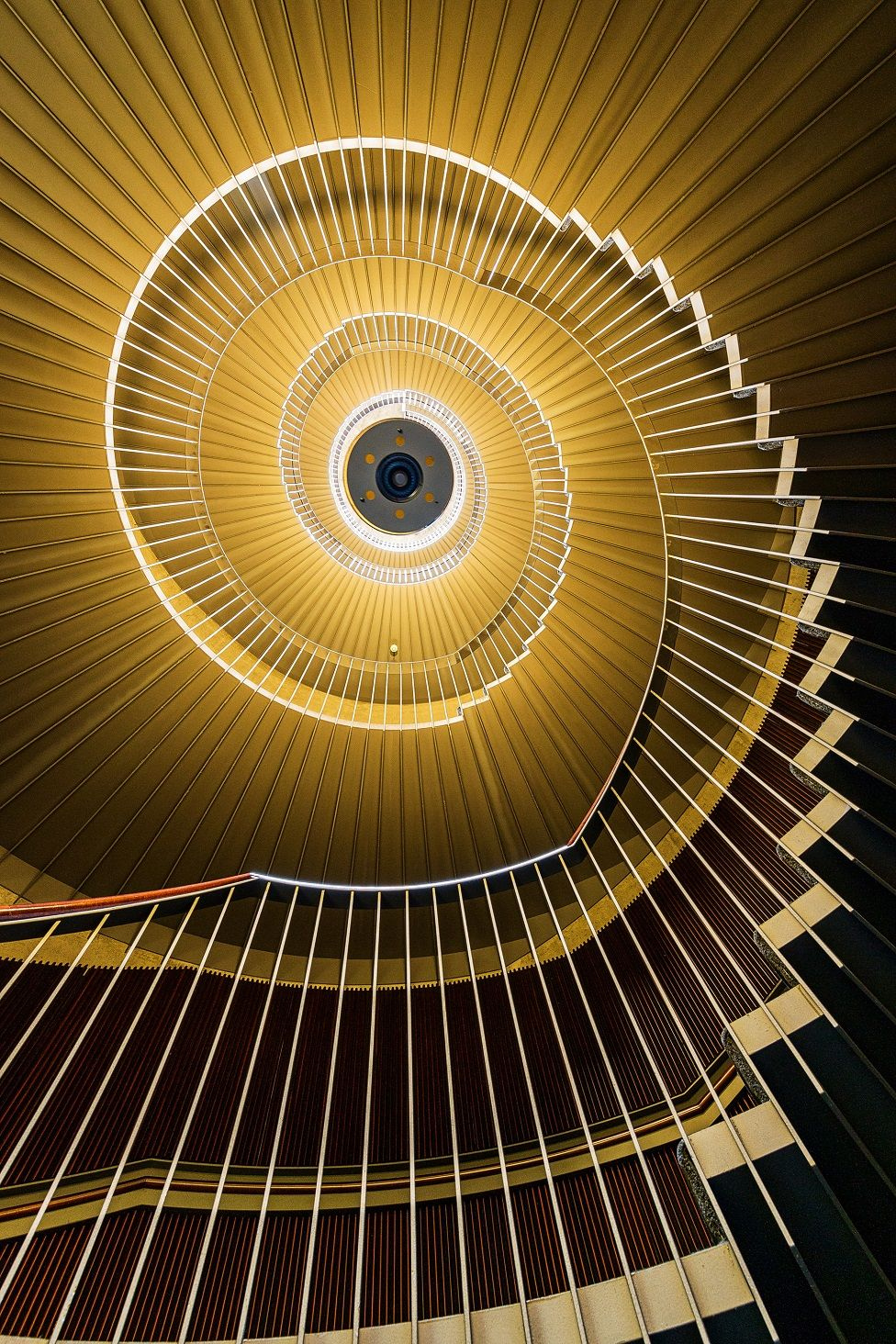A view looking upward at a spiral staircase
