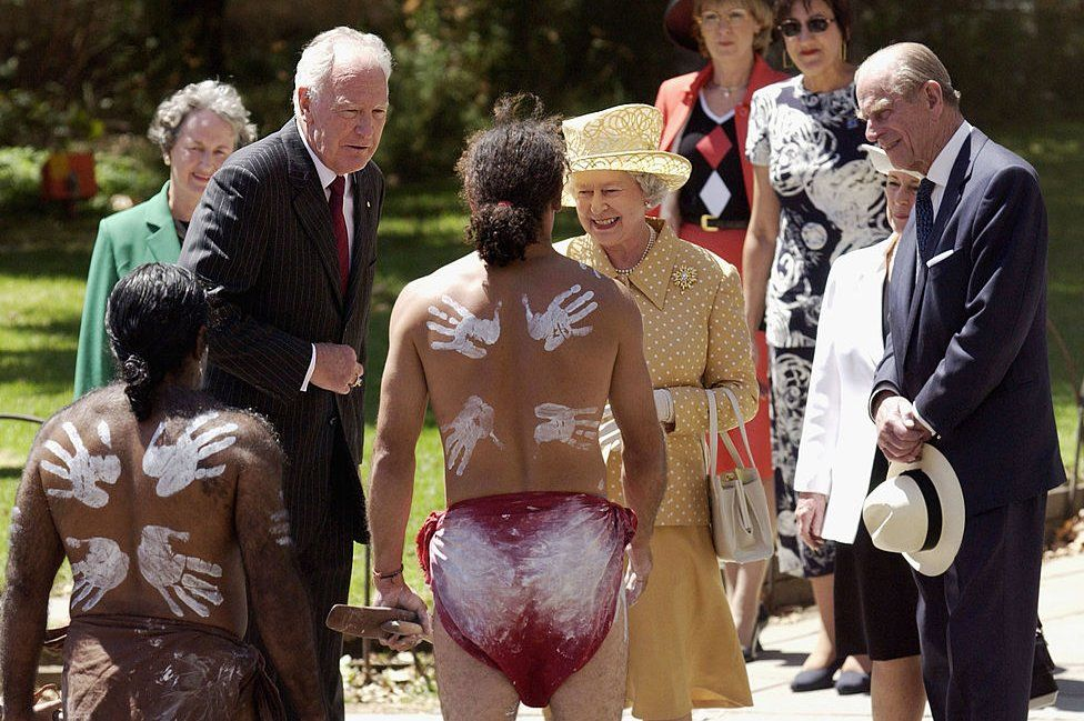 Queen Elizabeth II and her husband Prince Philip The Duke of Edinburgh, and their representative in Australia Governor-General Peter Hollingworth meet aboriginal dancers from the Paitya Dance Group during a ceremonial welcome to mark the beginning of the Royal visit to Australia, 27 February 2002 in Adelaide.