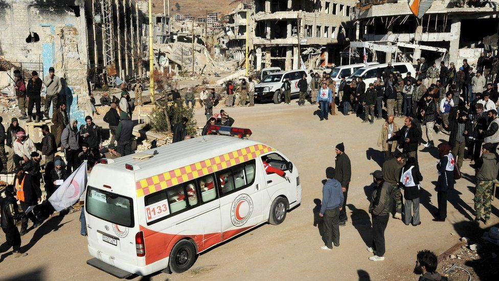 A Syrian Red Crescent ambulance carries a wounded Syrian opposition fighter, leave Zabadani, Syria (28 December 2015)