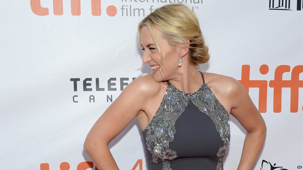 Kate Winslet grins as she's photographed at the Toronto Film Festival in September 2015