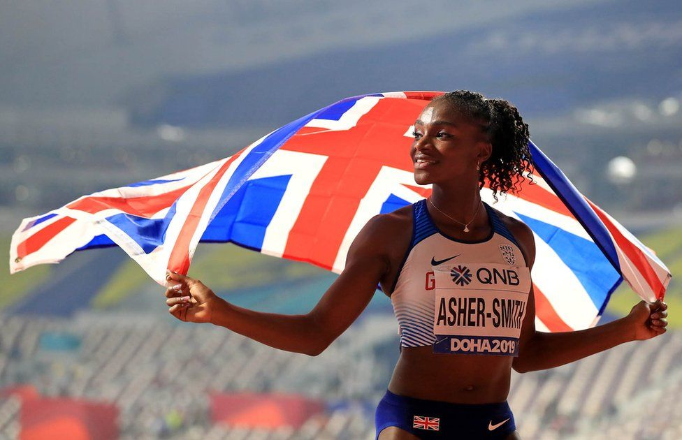 Dina Asher-Smith celebrates the silver medal after the 100m Women's Final