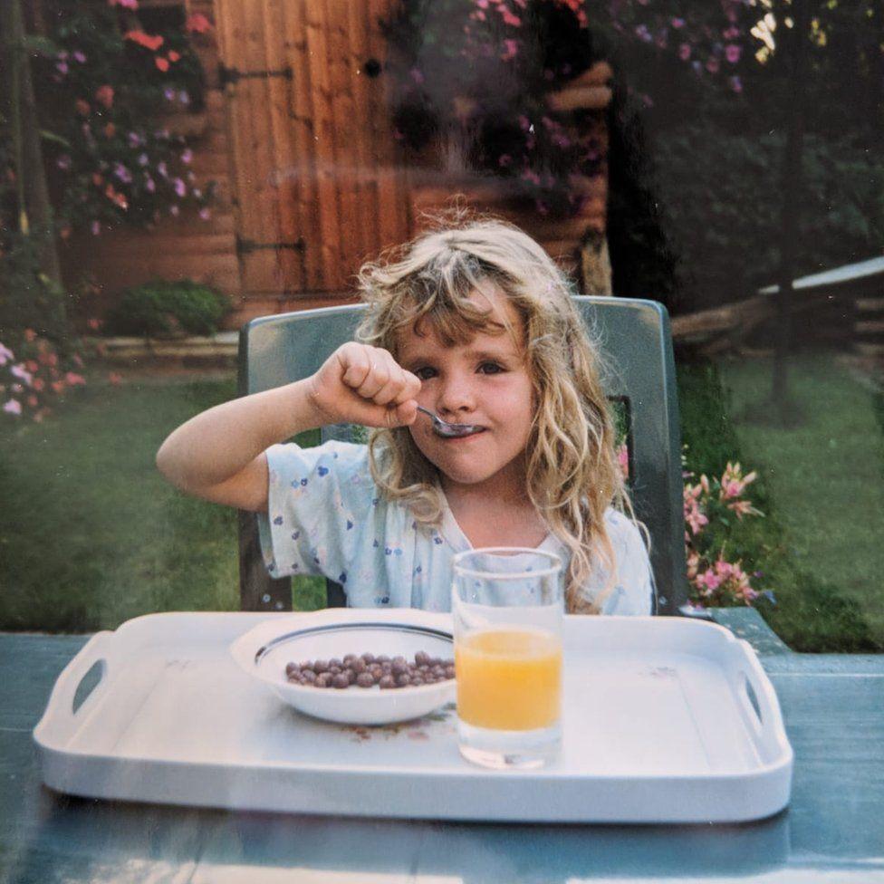 Loretta eating breakfast in her grandmother's garden