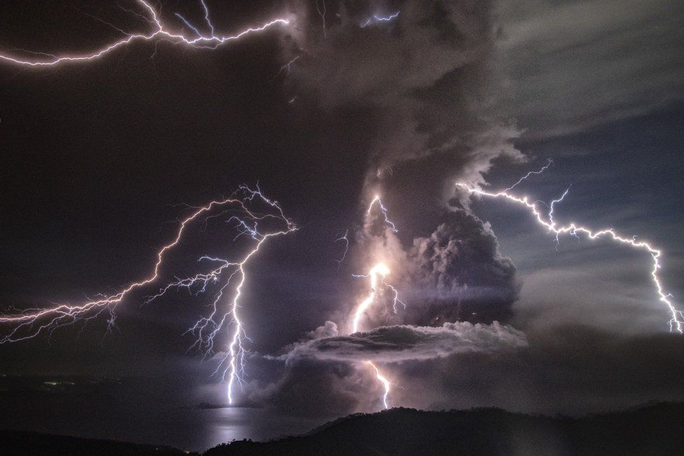 Lightning strikes as a column of ash surrounds the crater of Taal Volcano as it erupts on January 12