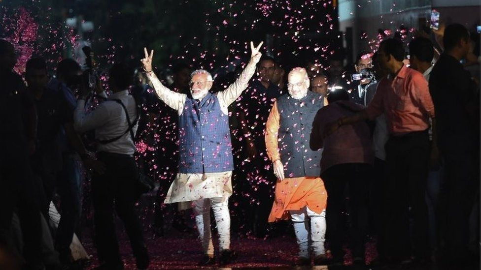 Many viewed the 2019 election as a referendum on Mr Modi (L) who won a landslide