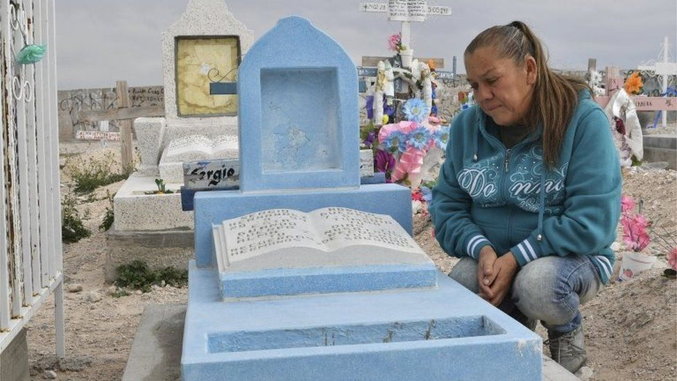 Maria Guadalupe Guereca visits the grave of her son, Sergio Hernandez, in Juarez, Mexico.