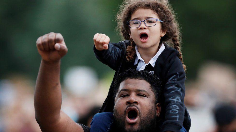Demonstrators react during a Black Lives Matter protest in Verulamium Park, St Albans