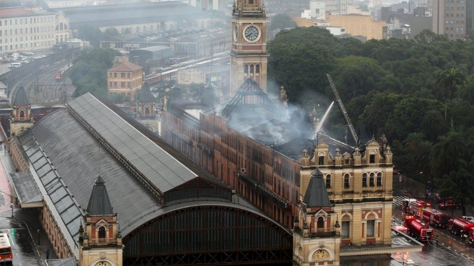Fire-fighters combat fire at Portuguese Language Museum in Sao Paulo, Brazil, December 21, 2015