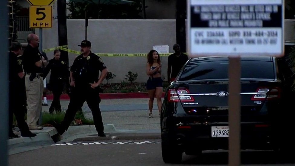 Pool-goers waited for information outside the apartment complex