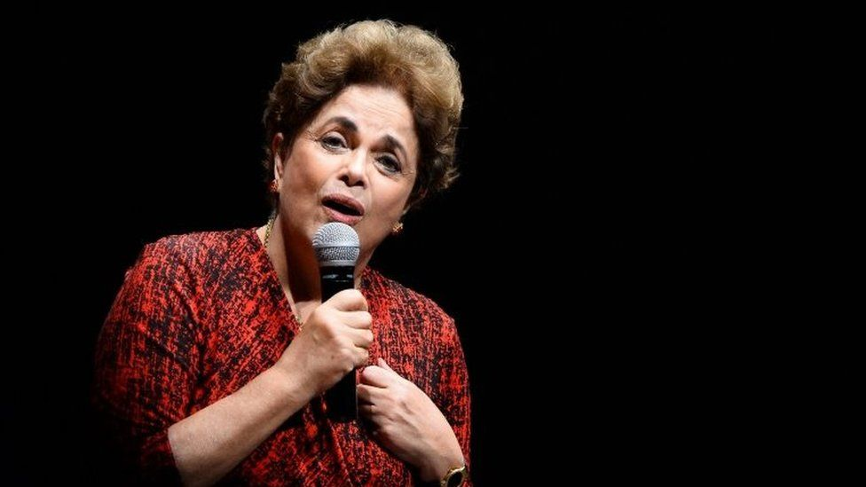 """Brazilian suspended President Dilma Rousseff speaks during a Workers"""" Party rally in Brasilia on August 24, 2016."""