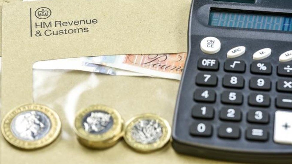 HMRC envelope, coins and calculator