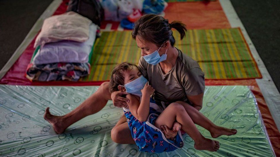 Homeless child and mother in shelter in Manila, Philippines - 1 April