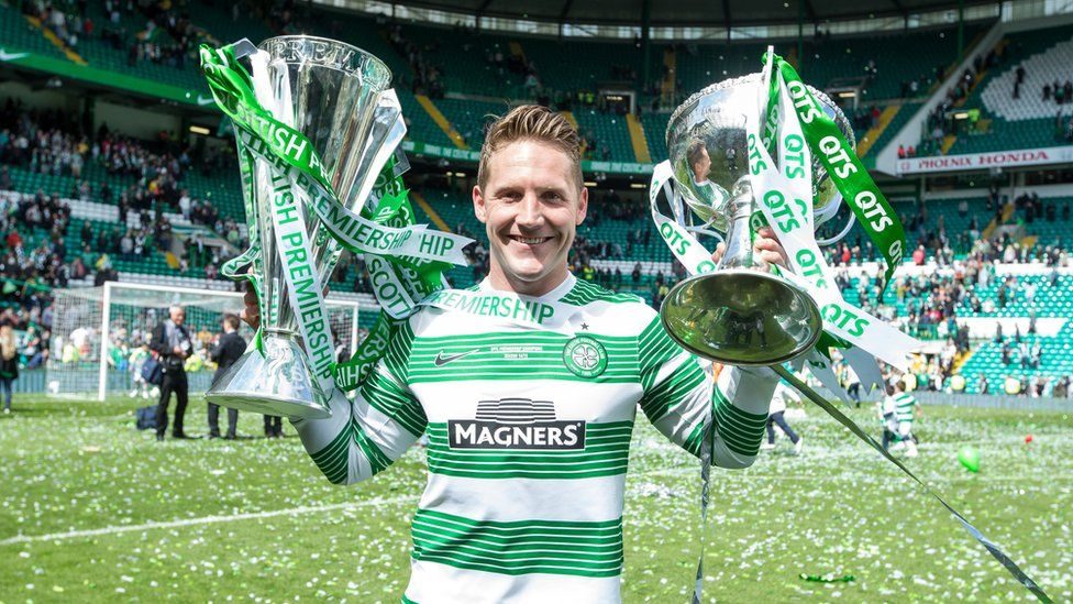Kris Commons lifts the League and League cup for Celtic after the Scottish Premiership Match between Celtic and Inverness Caley Thistle at Celtic Park on May 24, 2015