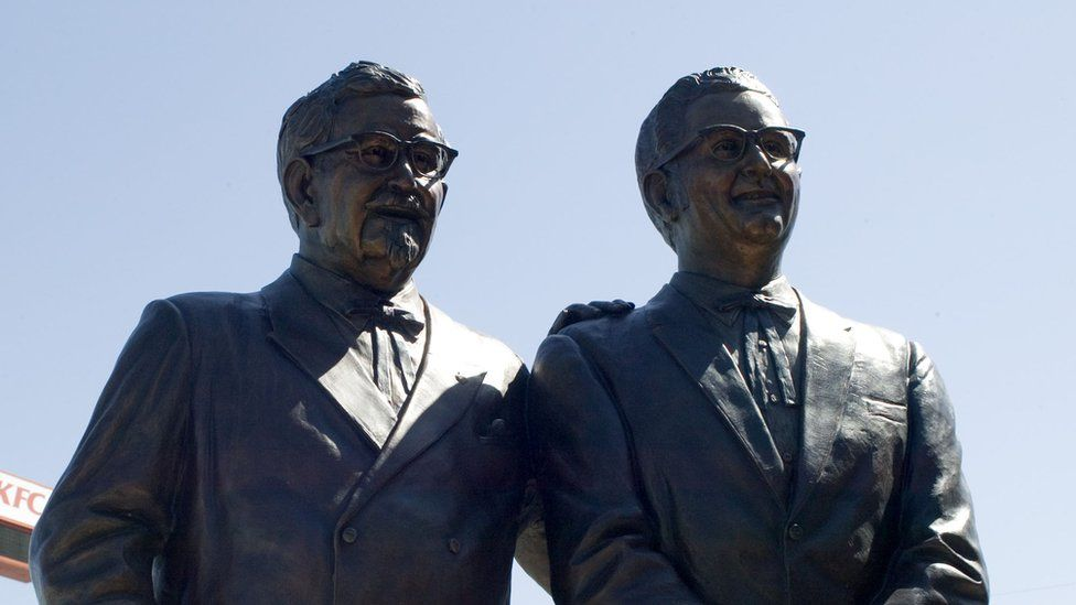 A statue of Colonel Harland Sanders (L) and Pete Harman stands at the newly rebuilt first KFC location on 11 August, 2004 in Salt Lake City, Utah. The world's first KFC location opens back up after the original 52 year-old building was razed. The eating establishment also doubles as a museum of memorabilia.