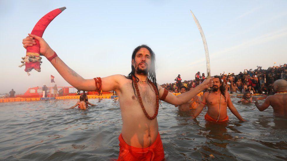Hindu holy men taking a dip at the Sangam