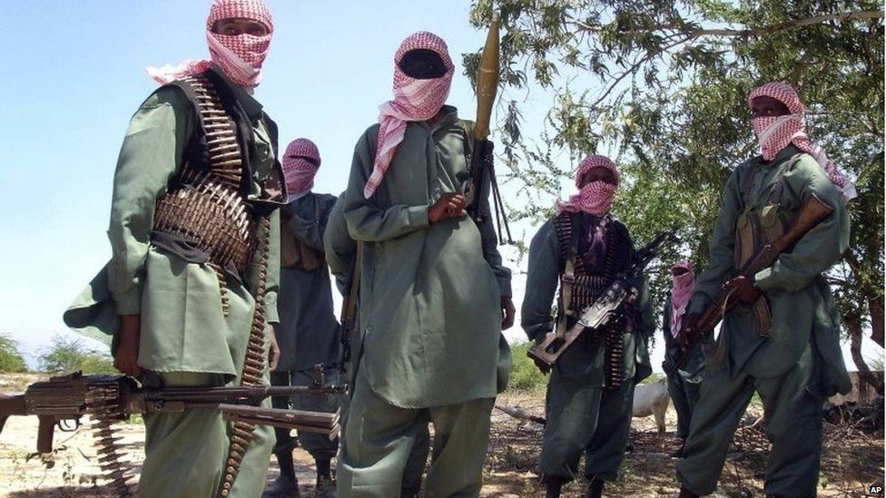 Members of Somalia's al-Shabab seen during exercises at their military training camp outside Mogadishu, Somalia - archive shot