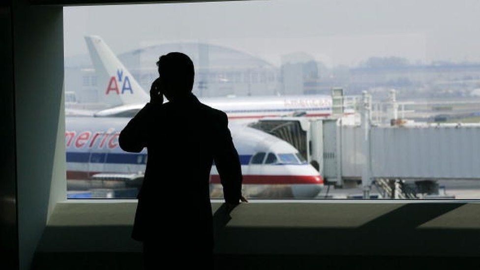 a passenger in an airport terminal