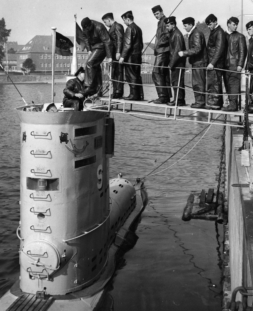 """The crew of the U-boat """"HAI"""" going aboard at Kiel in August 1958, the German Navy's first post-war manoeuvres"""
