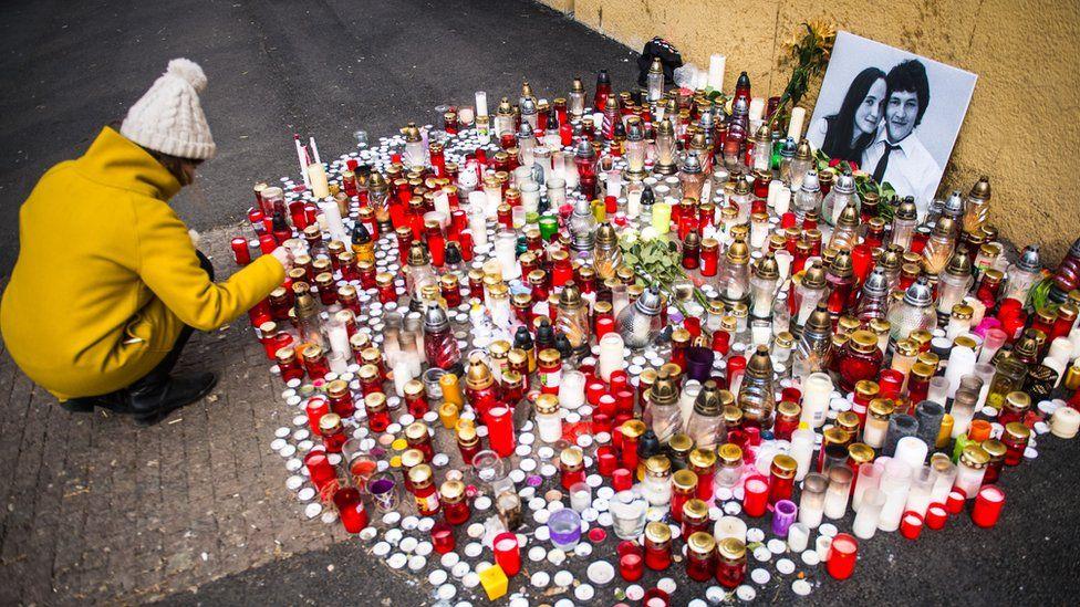 Candles commemorating slain investigative journalist Jan Kuciak