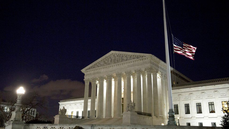 The flag outside the US Supreme Court is lowered in honour of Justice Scalia