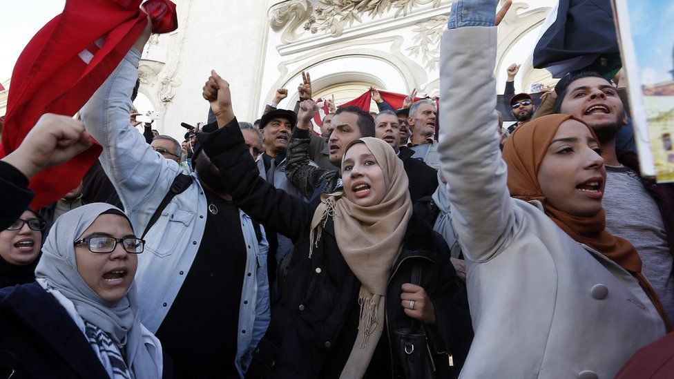 Tunisians shout slogans during a protest over the killing of Tunisian aviation engineer Mohamed Zouari, at Habib Bourgiba Avenue in Tunis, the capital.