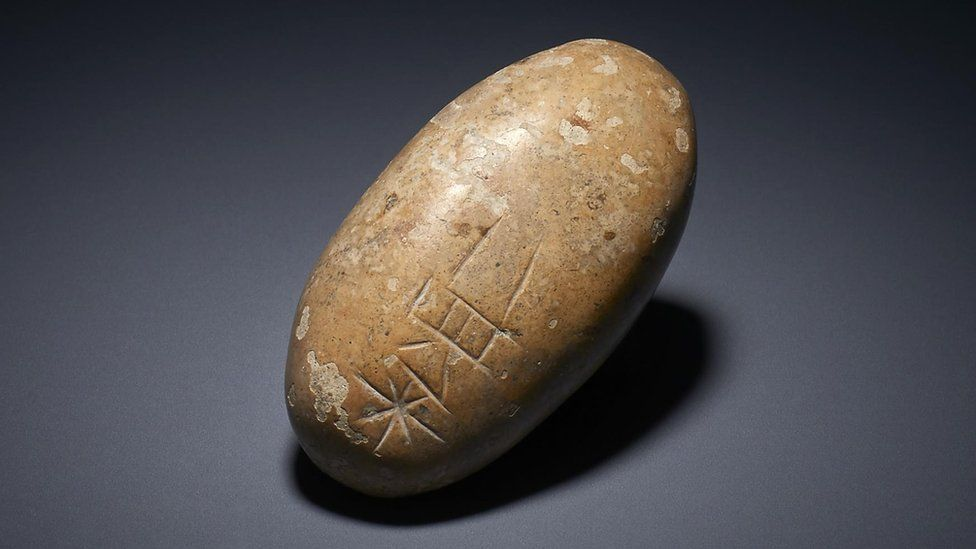 Pebble with inscription