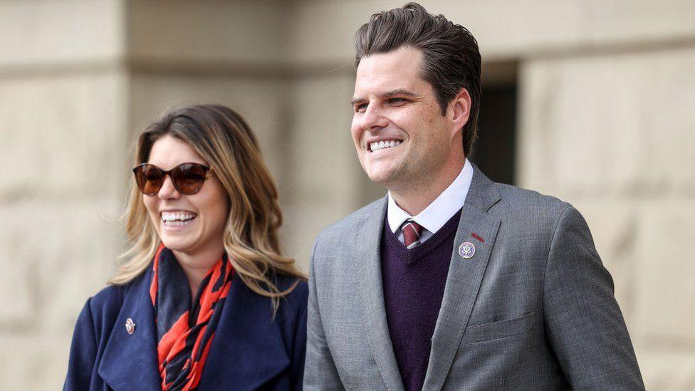 Representative Matt Gaetz walks with his fiancée Ginger Luckey