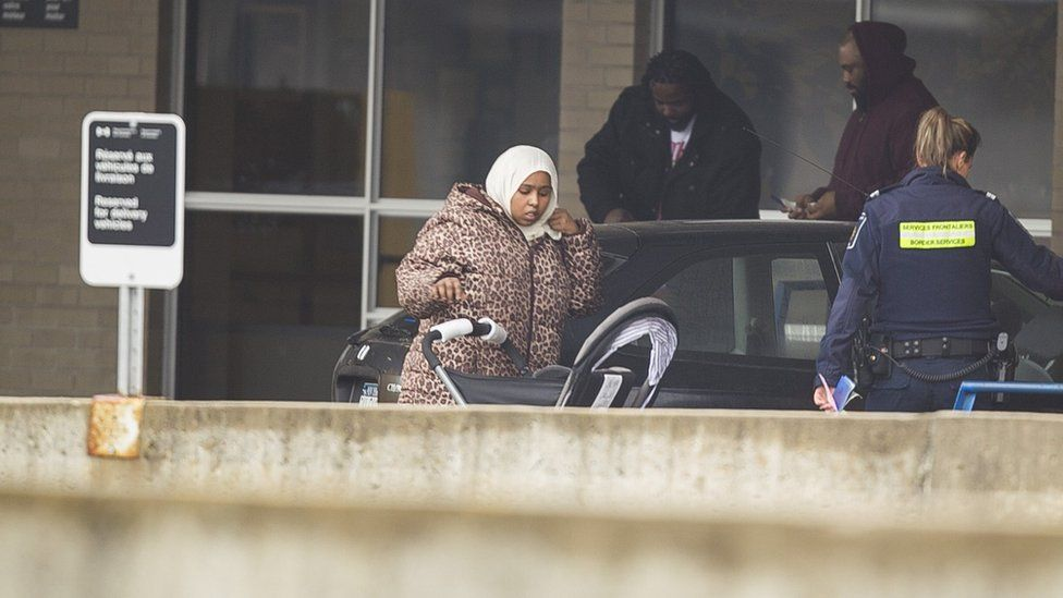 A woman from Djibouti is detained by Canada Border Services agents after arriving at the Canada-US border at Blackpool, Quebec, February 25 2017