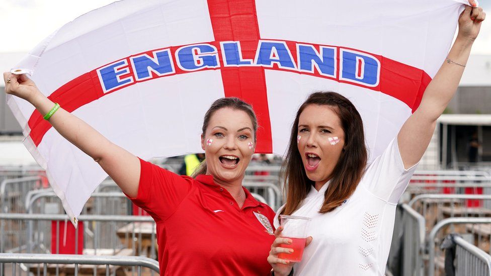 England fans in Manchester fly the national flag ahead of the match