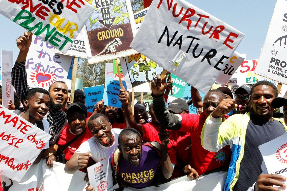 Protesters in Nairobi holding placards