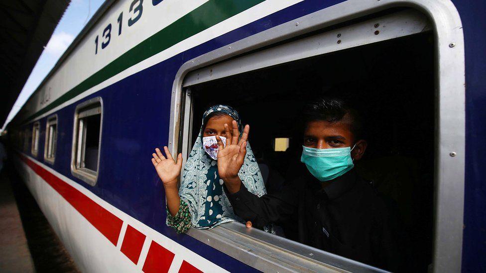 Masked passengers on a Pakistan Railways train, Karachi (10 May)