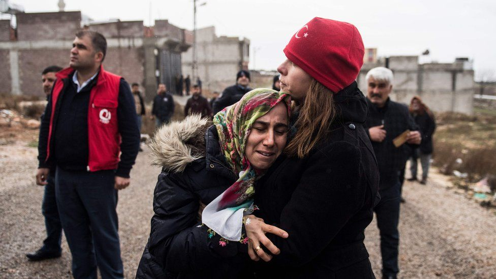 Kilis resident Fevziye Demir cries after a rocket fired from Syria hit her house on 23 January 2018
