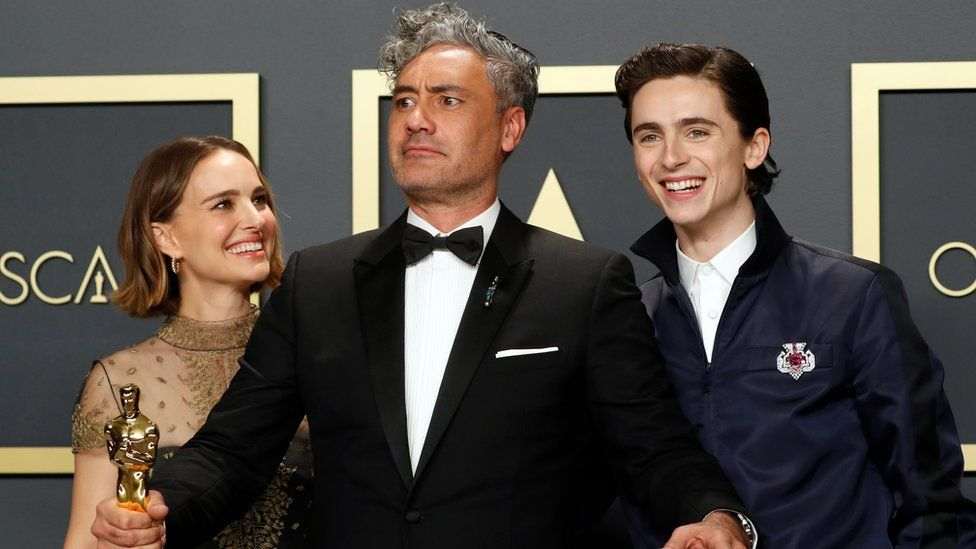 Timothee Chalamet (right) and Natalie Portman (left) with Taika Waititi